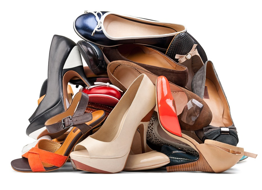 Pile of various female shoes, with clipping path