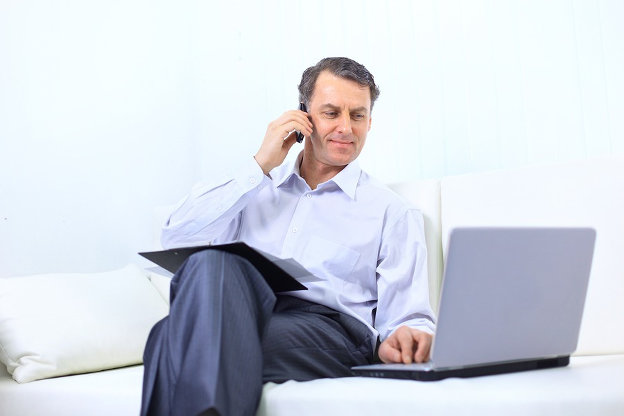 entrepreneur working from home looking very relaxed in his sofa
