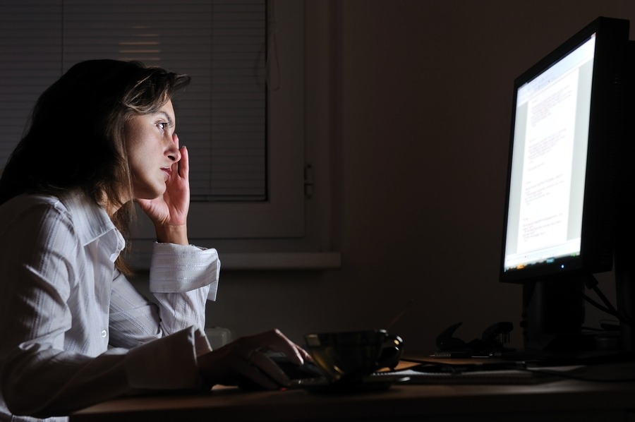Business person working overtime with neck pain