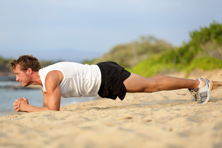 Crossfit training fitness man doing plank core exercise working